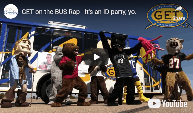 Youtube video screenshot of Greeley school mascots standing in front of Greeley Evans Transit bus.